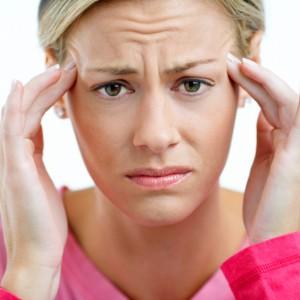 Stressed Woman Having Mood Swings and Headache
