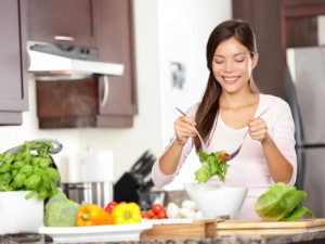 Woman Eating Right and Healthy Food: Vegetables