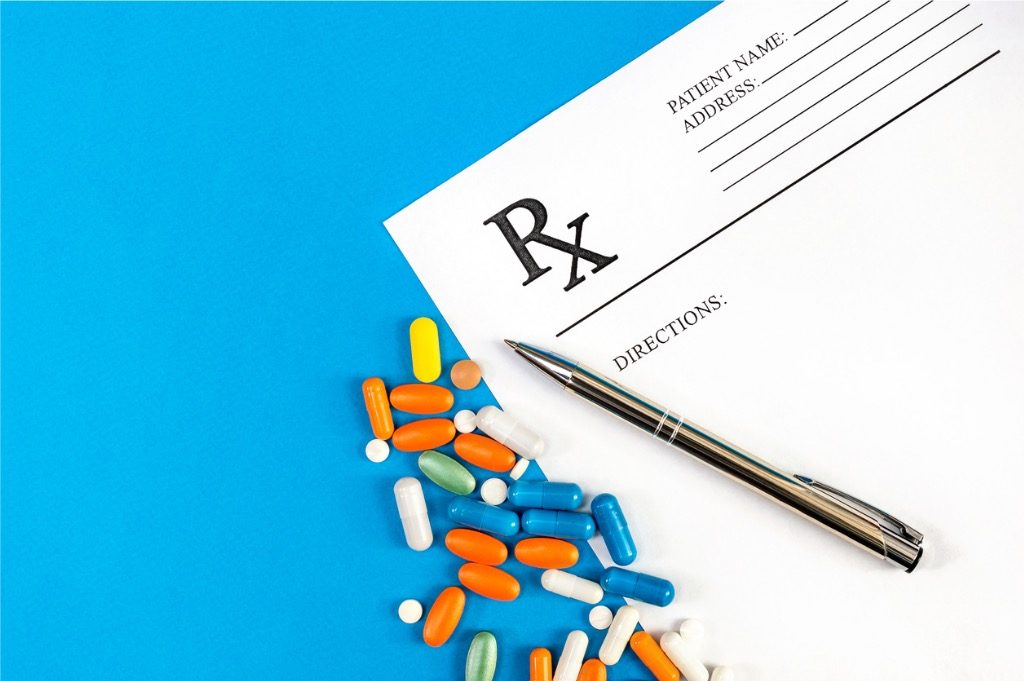 prescription-form-with-pills-and-pen-with-on-blue-top-view-medical-picture-id902944658-2